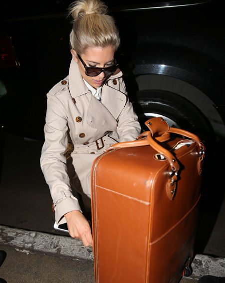 The Saturdays star Mollie King looking at her luggage after her long flight