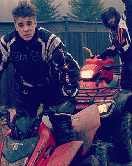 Justin Bieber blows off steam with pal dirt biking