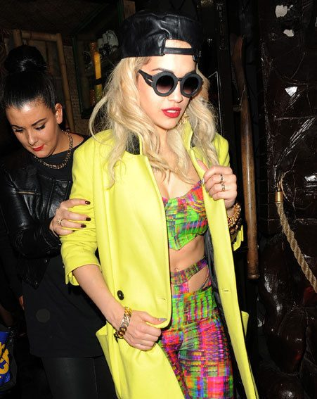 Rita Ora stepped out in a ridiculously bright ensemble when she partied with pals last night