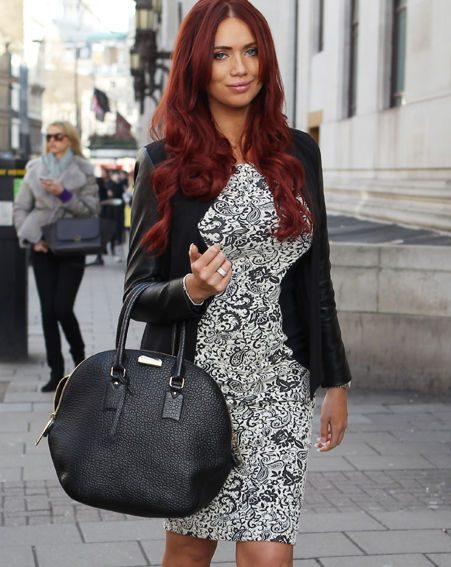 Amy Childs wore a floral printed black and white bodycon that hugged her famous curves