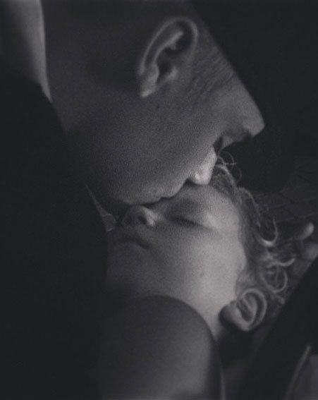 Justin is seen kissing his younger brother as he puts him to bed
