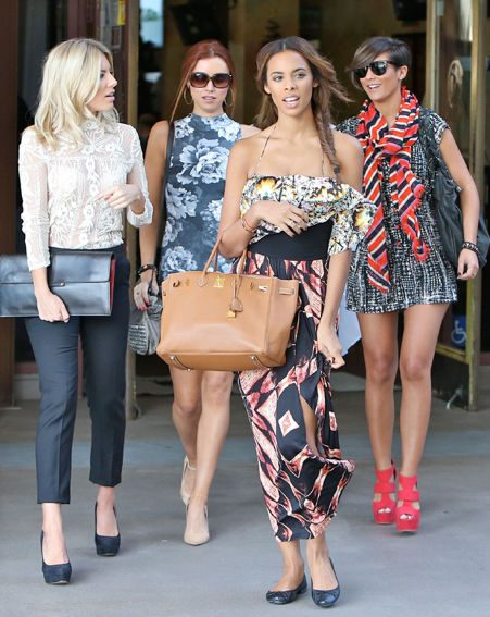 The Saturdays dressed to impress while strolling along an exclusive LA shopping street on Friday