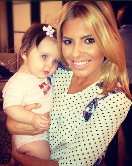 Mollie King shared this adorable snap of herself snuggling up to cute lil' un Aoife Belle
