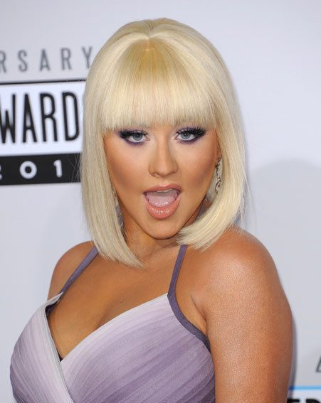 Christina Aguilera looked stunning with her blonde bob and purple frock