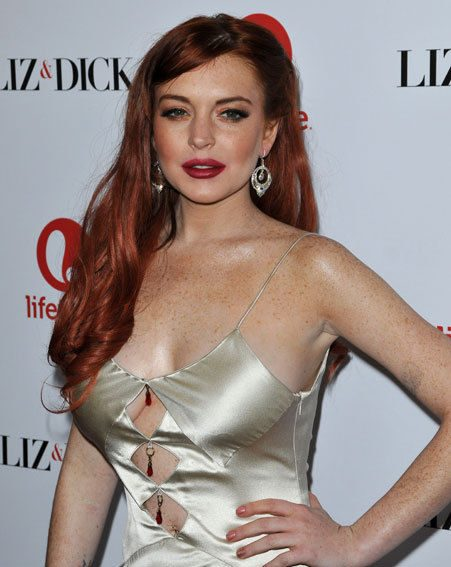 Lindsay Lohan wore a trashy gold gown to the Liz & Dick premiere