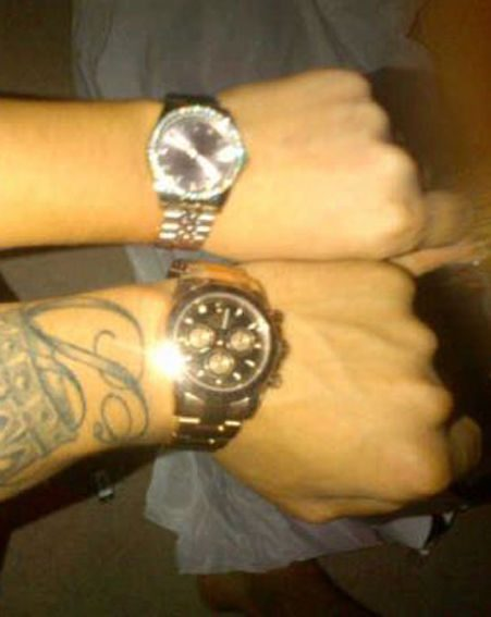 Tulisa shared a snap of herself and Danny Simpson wearing matching watches on Twitter