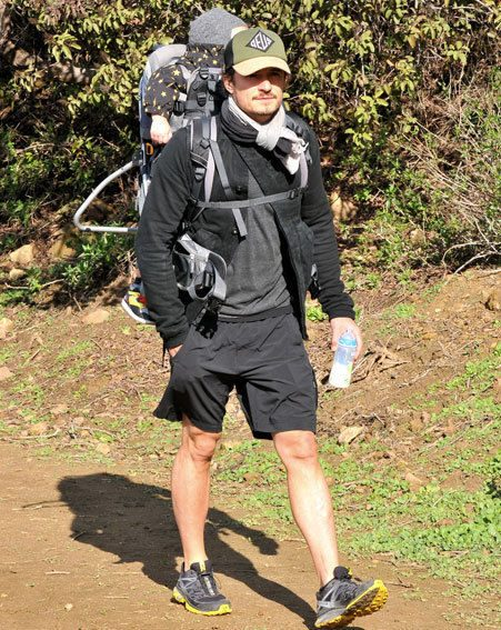 Orlando Bloom took his son Flynn out for a hike in Hollywood yesterday without Miranda Kerr
