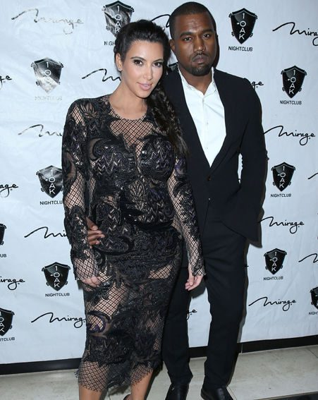 Kim Kardashian and Kanye West looked very loved up on the red carpet