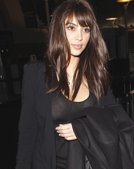 Kim Kardashian is reportedly looking to Posh Spice for pointers on how to look stylish pregnant