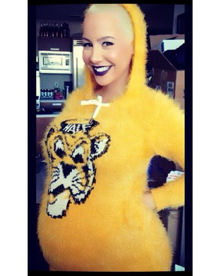 Amber Rose couldn't stop smiling as she wore the cute all-in-one fluffy outfit